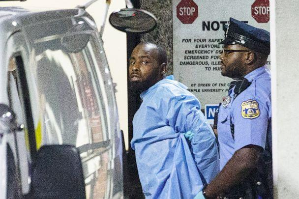 PHOTO: Police take shooting suspect, Maurice Hill, into custody after a standoff on Aug. 14, 2019 with police, that wounded several police officers, in Philadelphia. (Elizabeth Robertson/AP)