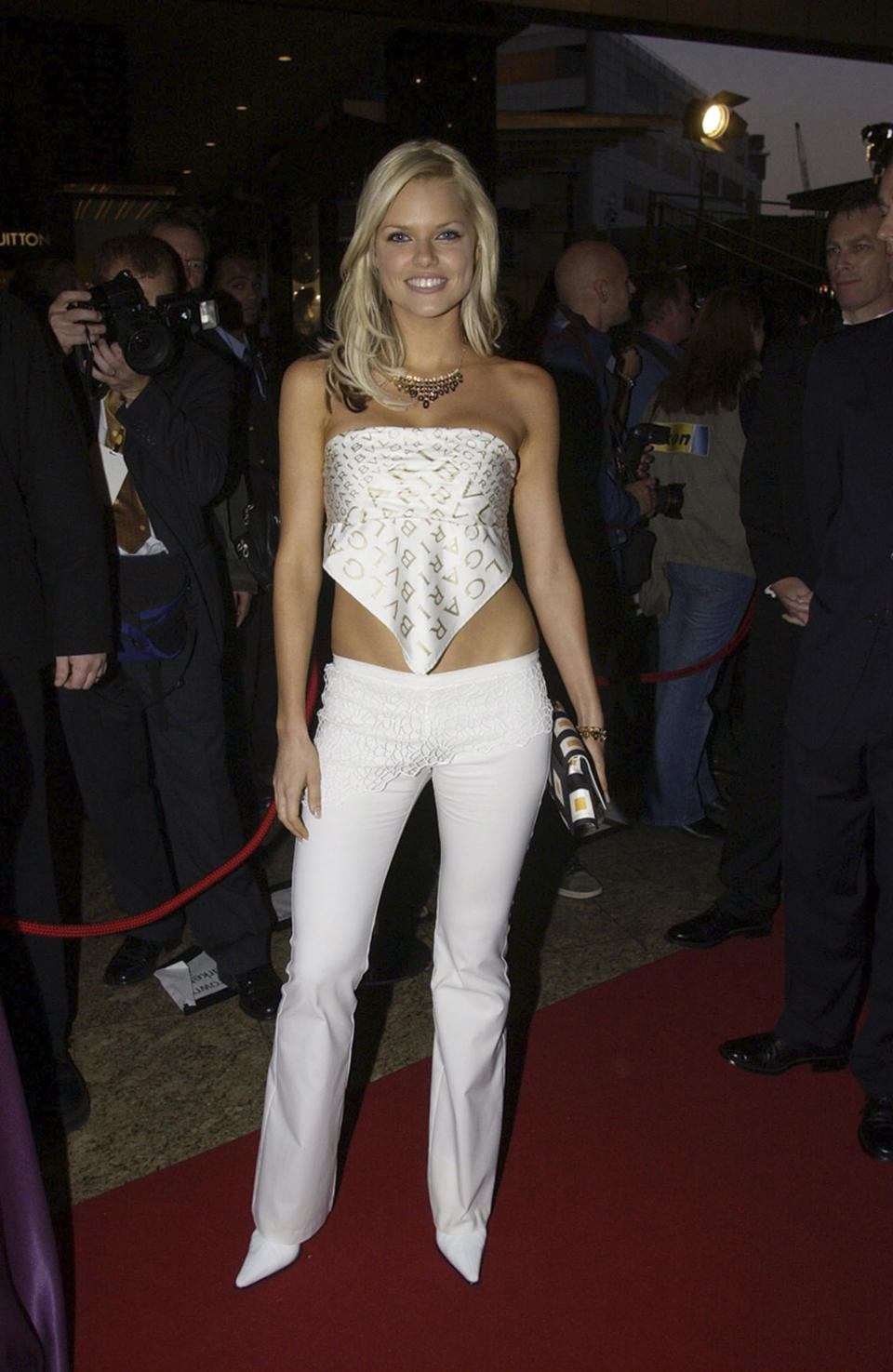 Blonde bombshell Sophie Monk put a fashion foot wrong in this all-white ensemble in 2002. The ex-Bachelorette paired her low-waisted flares with pointy-toe heels and what looks to be a scarf as a boob-tube top. It's all a bit casual for a red carpet - but at least she didn't have to get changed before the after party. Photo: Getty Images.