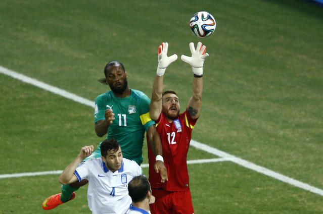 Greece's Glykos makes a save near Ivory Coast's Drogba during their 2014 World Cup Group C soccer match in Fortaleza