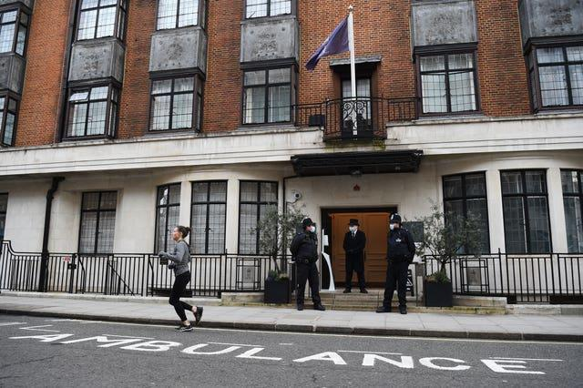 Police officers and hospital security staff guard ing Edward VII's Hospital where the duke is under