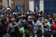Cuba's President Miguel Diaz Canel walks with his followers after an anti-government protest in San Antonio de los Banos, Cuba, Sunday July 11, 2021. Hundreds of demonstrators went out to the streets in several cities in Cuba to protest against ongoing food shortages and high prices of foodstuffs, amid the new coronavirus crisis. (AP Photo/Ramon Espinosa)