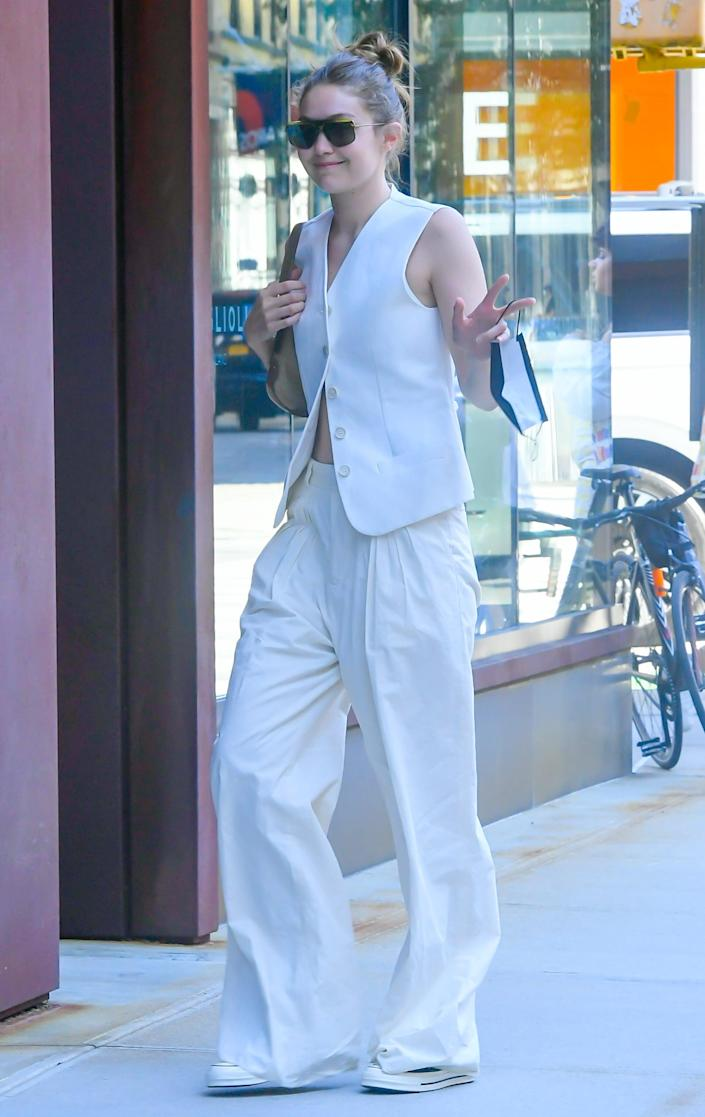 <p>The supermodel stepped out in NYC looking chic in this vest-and-trouser combo.</p>