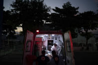 A COVID-19 patient arrives in an ambulance to the Sao Jose municipal hospital, in Duque de Caxias, Brazil, Wednesday, March 24, 2021. (AP Photo/Felipe Dana)
