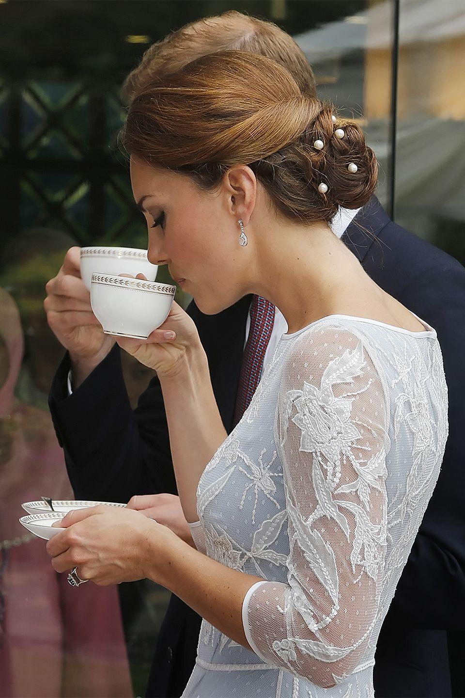 <p>Pearl pins dressed-up The Duchess of Cambridge's twisted chignon in 2012.</p>