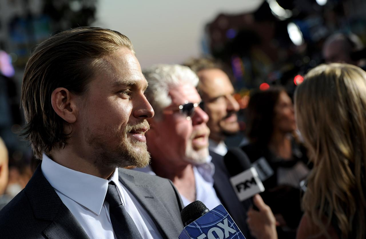 "LOS ANGELES, CA - SEPTEMBER 07: (L-R) Actors Charlie Hunnam, Ron Perlman and Kim Coates arrive at the premiere of FX's ""Sons of Anarchy"" Season 6 at the Dolby Theatre on September 7, 2013 in Los Angeles, California. (Photo by Kevin Winter/Getty Images)"