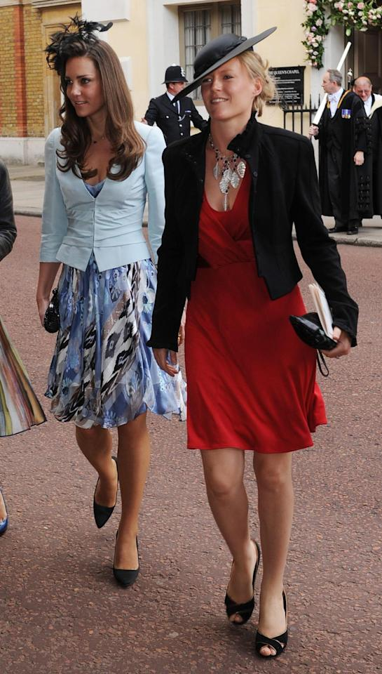 <p>The Duchess of Cambridge, then Kate Middleton, arrived at The Queen's Chapel in London in a printed knee-length dress with a pale blue jacket. The royal-to-be accessorised with a feather hat. <em>(Photo: PA)</em> </p>