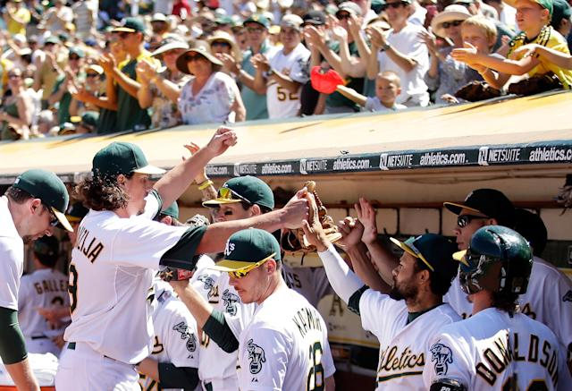 The Oakland Athletics announces a 10-year lease extension deal with the city council to continue playing MLB games at the team's 48-year-old home ballpark (AFP Photo/Ezra Shaw)