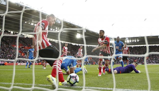 <p>Southampton's Steven Davis clears off the line </p>
