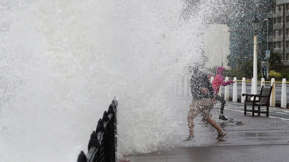 Waves crash over the promenade in Dover, Kent, as wind and rain batters Britain (Picture: PA)