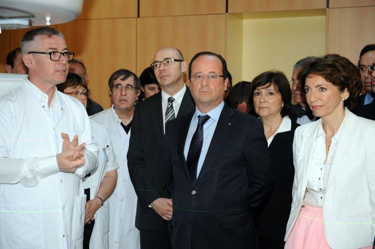 French President Francois Hollande (centre) visits the Bretagne Sud hospital in Brest, western France, on July 1, 2013. Hollande has told the United States to immediately cease spying on European institutions, after reports of covert US surveillance of EU diplomatic missions