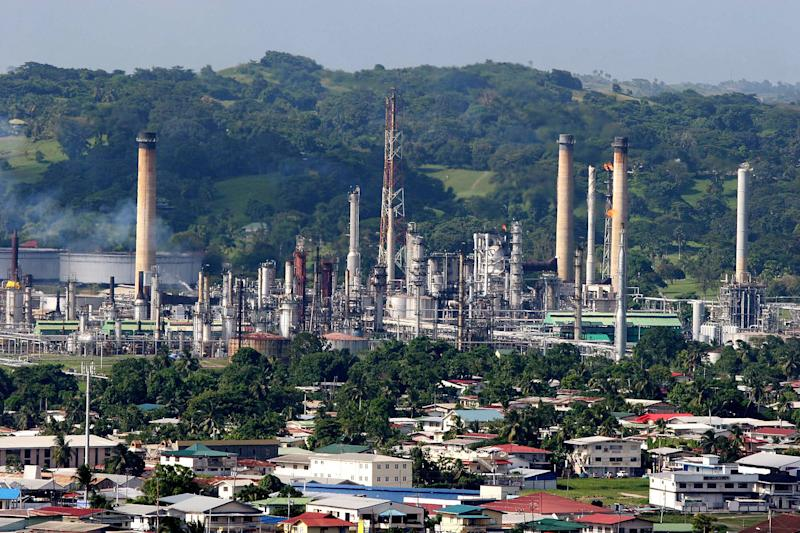 FILE - In this Sept. 5, 2005 file photo, the refinery of the state-owned Petroleum Company of Trinidad and Tobago Ltd., PETROTRIN, is shown in Pointe-a-Pierre, on the Gulf of Paria, Trinidad & Tobago. From the Bahamas and Cuba down to Aruba and Suriname, international oil companies are lining up to locate potentially rich offshore deposits in the Caribbean. The countries hope drilling could lead to a black-gold bonanza, easing demand for imported oil and diversifying their economies. (AP Photo/Shirley Bahadur, File)