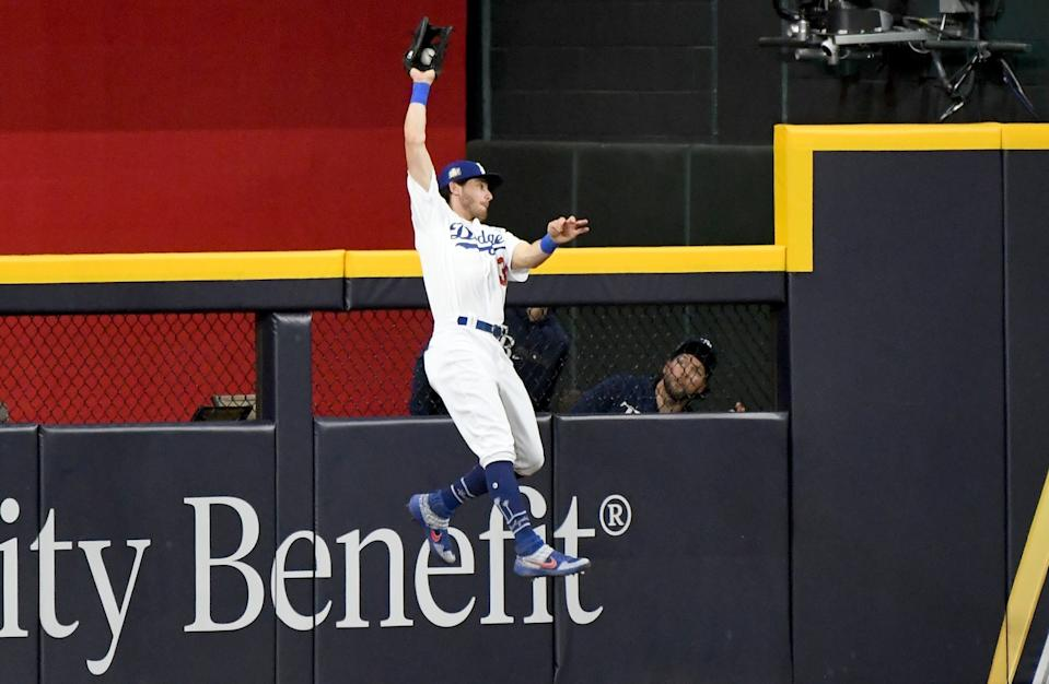 Dodgers center fielder Cody Bellinger makes a catch at the wall in the 9th inning in Game 1