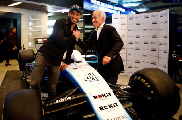 Israeli racing driver Roy Nissany and Sylvan Adams pose for a photo after Nissany signed with British Formula One motor racing team Williams in Tel Aviv