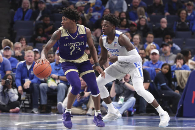 Memphis' Damion Baugh (10) moves in on Alcorn States' Dominic Brewton (23) in the second half of an NCAA college basketball game Saturday, Nov. 16, 2019, in Memphis, Tenn. (AP Photo/Karen Pulfer Focht)