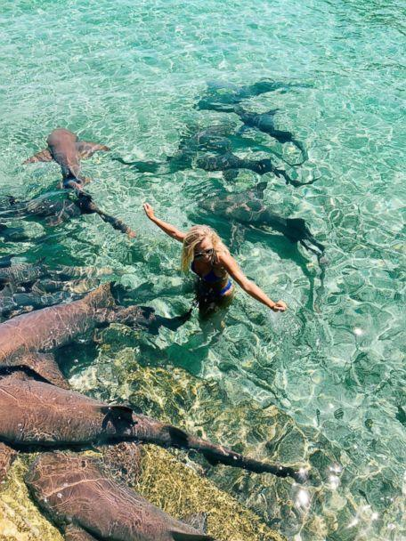 PHOTO: Instagram model Katarina Zarutskie stands alongside nurse sharks in the Bahamas. (Tom Bates)