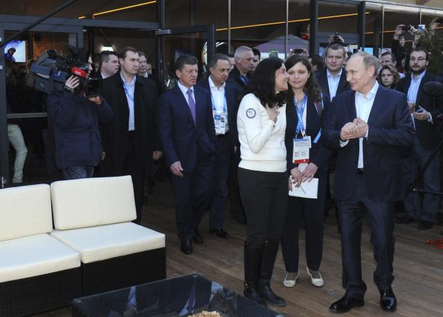 Russia's President Vladimir Putin (R) visits Team USA House at the U.S. Olympic Committee headquarters in the Olympic Park during the Sochi 2014 Winter Olympics Games, February 14, 2014. REUTERS/Mikhail Klimentyev/RIA Novosti/Kremlin (RUSSIA - Tags: POLITICS OLYMPICS SPORT) ATTENTION EDITORS - THIS IMAGE HAS BEEN SUPPLIED BY A THIRD PARTY. IT IS DISTRIBUTED, EXACTLY AS RECEIVED BY REUTERS, AS A SERVICE TO CLIENTS