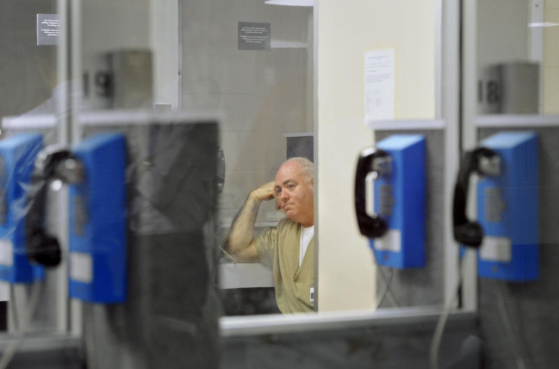 Michael Skakel waits in a visitation room for a decision during a parole hearing at McDougall-Walker Correctional Institution in Suffield, Conn., Wednesday, Oct. 24, 2012. Parole officials denied Skakel's first bid for parole since he was convicted a decade ago of killing his neighbor in 1975. Skakel is serving 20 years to life for fatally beating Martha Moxley with a golf club in Greenwich when they were 15-year-old neighbors. (AP Photo/Jessica Hill, Pool)