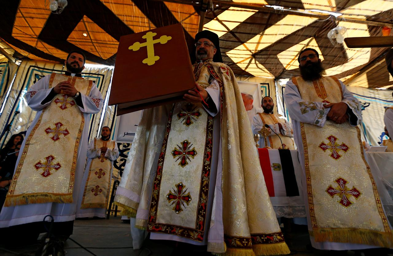 Members of the Coptic clergy attend a mass, ahead of Pope Francis' visit, in a church in Cairo, Egypt April 28, 2017. REUTERS/Amr Abdallah Dalsh     TPX IMAGES OF THE DAY
