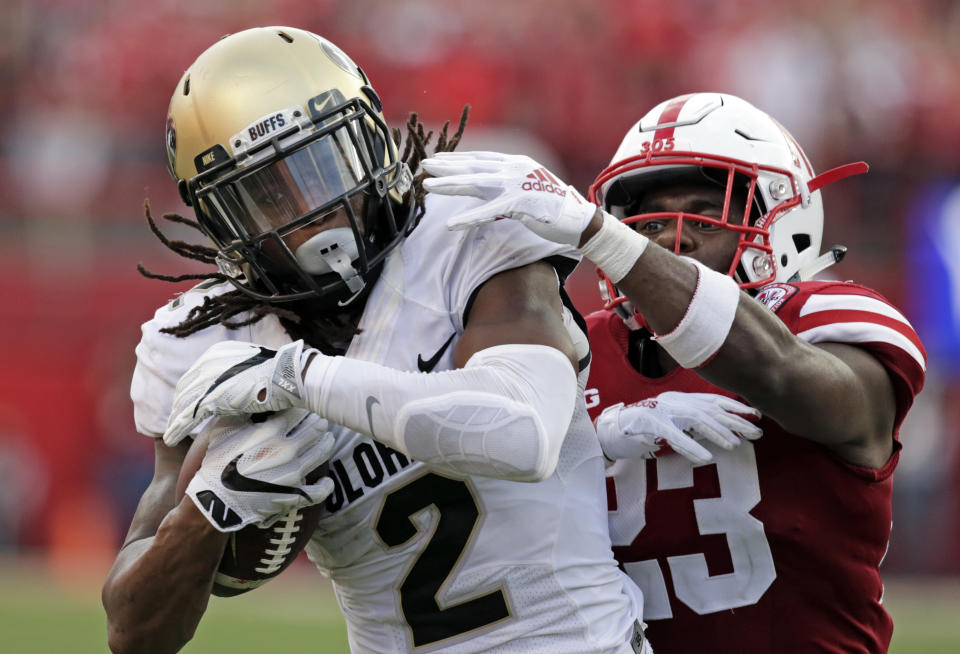 """FILE - In this Sept. 8, 2018, file photo, Colorado wide receiver Laviska Shenault Jr. (2) makes a touchdown reception against Nebraska defensive back Dicaprio Bootle (23) during the second half of an NCAA college football game in Lincoln, Neb. Shenault is a shy, soft-spoken person. That is, until he steps onto the field and transforms into an alter ego he's nicknamed """"Viska 2Live,"""" becoming an electric playmaker who's vaulted into the conversation for the Heisman Trophy. (AP Photo/Nati Harnik, File)"""