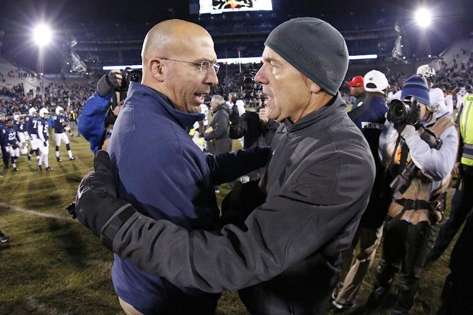 Penn State head coach James Franklin, left, and Michigan State head coach Mark Dantonio meet on the field after the Spartans' 34-10 win in an NCAA college football game in State College, Pa., Saturday, Nov. 29, 2014. (AP Photo/Gene J. Puskar)