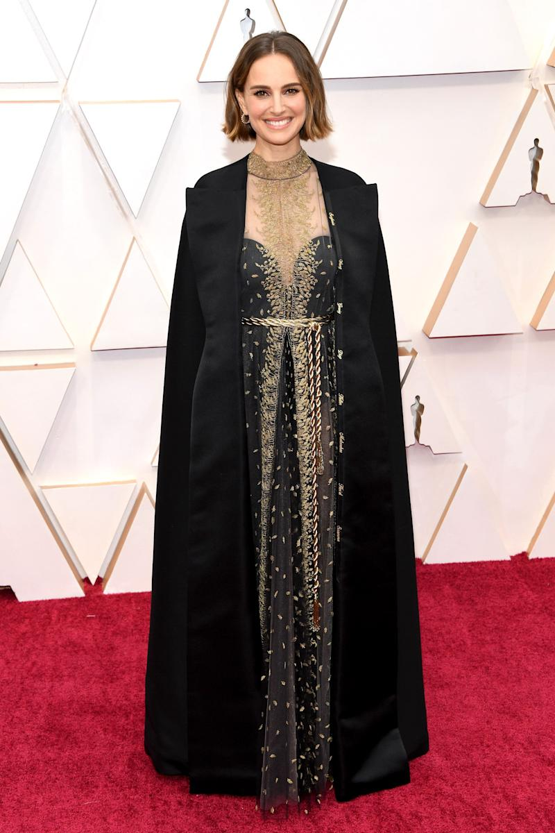 """This Dior gown-and-cape combo looks incredible even before you find out <a href=""""https://www.huffpost.com/entry/natalie-portman-oscars-cape-female-directors_n_5e409ae3c5b6f1f57f1354a0"""" target=""""_blank"""" rel=""""noopener noreferrer"""">it's also a protest</a> against the all-male director nominees."""