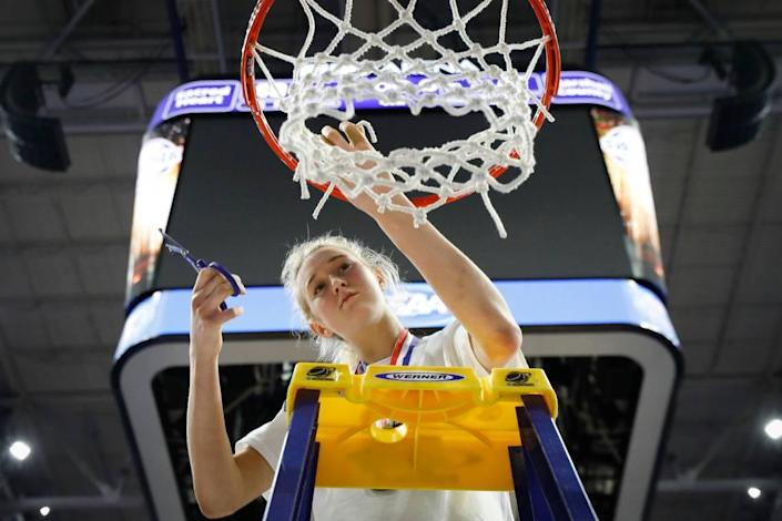 Sacred Heart's Josie Gilvin, who was named MVP of the Sweet 16, took her piece of the net during the Valkyries' championship celebration.
