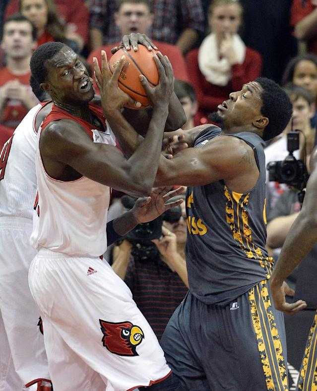 Louisville's Mangok Mathiang, left, battles Southern Mississippi's Michael Craig for a rebound during the first half of an NCAA college basketball game Friday Nov. 29, 2013, in Louisville, Ky. (AP Photo/Timothy D. Easley)