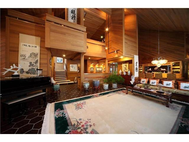"<p>The home boasts vaulted ceilings and marble floors throughout. (Listing via <a href=""https://www.point2homes.com/CA/Home-For-Sale/AB/Calgary/Pump-Hill/15-PUMP-HILL-CL-SW/37432026.html"" rel=""nofollow noopener"" target=""_blank"" data-ylk=""slk:Point2Homes"" class=""link rapid-noclick-resp"">Point2Homes</a>) </p>"