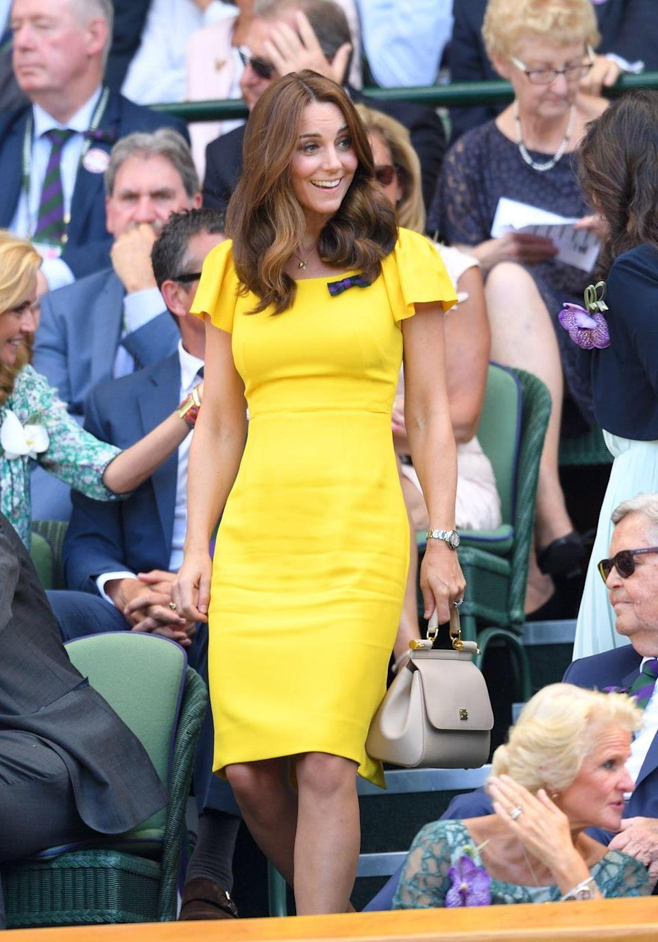"""<p>Kate wore this sunny yellow dress to Wimbledon in 2018. The Duchess of Cambridge <a href=""""https://www.cosmopolitan.com/style-beauty/fashion/a22150588/kate-middleton-meghan-markle-yellow/"""" rel=""""nofollow noopener"""" target=""""_blank"""" data-ylk=""""slk:has a long history"""" class=""""link rapid-noclick-resp"""">has a long history</a> of wearing this color, and for good reason—it looks s-t-u-n-n-i-n-g on her.</p>"""