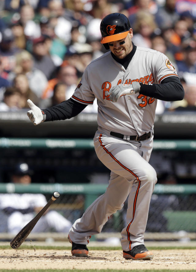 Baltimore Orioles' Matt Wieters reacts after striking out during the fourth inning of a baseball game against the Detroit Tigers in Detroit, Sunday, April 6, 2014. (AP Photo/Carlos Osorio)