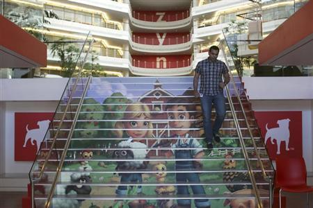 Player avatars from Zynga's FarmVille 2 are seen on a stairway at the entrance to Zynga headquarters in San Francisco