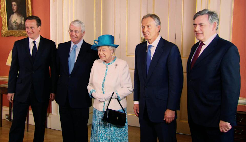 Undated handout screen grab issued by Oxford Film and Television of the Queen meeting Prime Minister David Cameron plus former Prime Ministers John Major, Tony Blair and Gordon Brown at 10 Downing Street, from the Our Queen documentary, a landmark, in-depth portrait of Queen Elizabeth II during one of the most momentous years of her reign.
