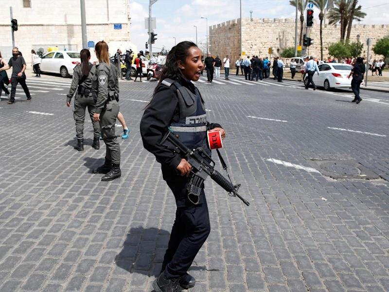 A police officer patrolling the scene after the attack