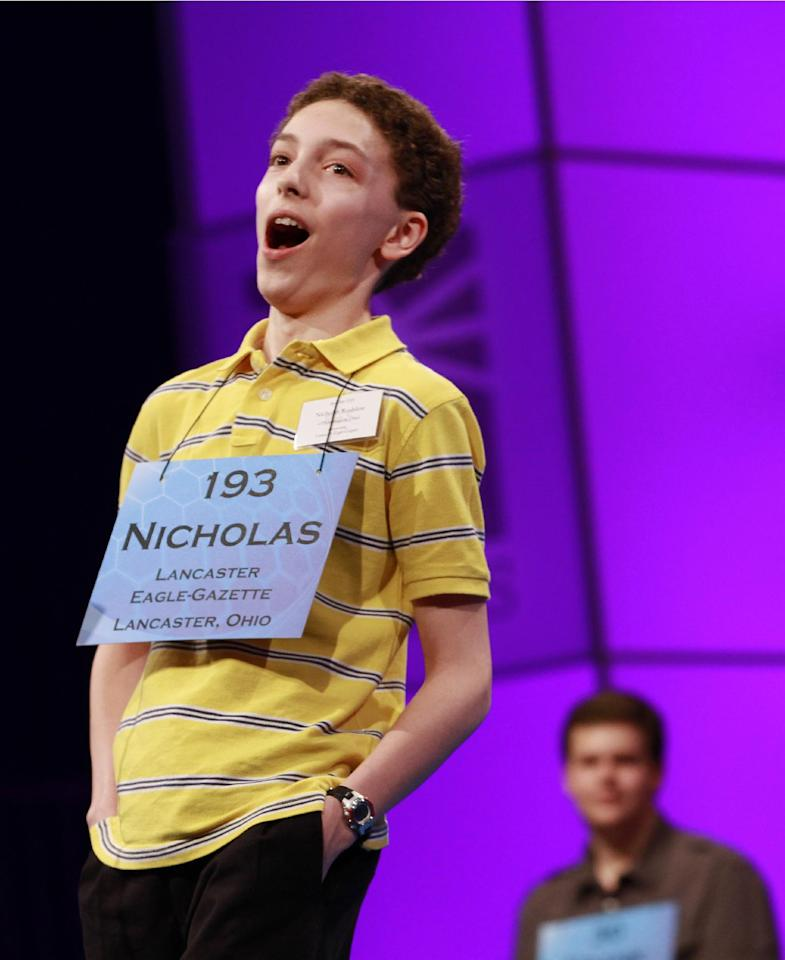 Nicholas Rushlow, 14, of Pickerington, Ohio, reacts after spelling a word correctly during the sixth round of the semifinals at the National Spelling Bee, Thursday, May 31, 2012, in Oxon Hill, Md., making the five-time bee attendee one of Thursday night's nine finalists. (AP Photo/Jacquelyn Martin)