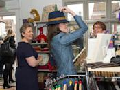 <p>While touring a charity shop in England, Kate had on the M by Missoni coat and tried on a fun hat! She didn't buy it though. </p>