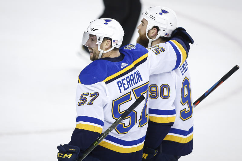 Perron scores in OT to lift Blues past Flames 3-2