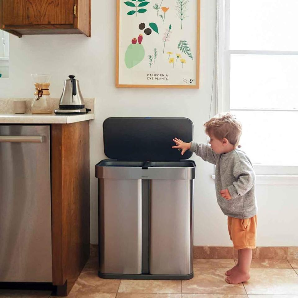 """<p>Consider this voice-controlled garbage bin the Rolls Royce of trash receptacles. Designed with sensors and voice-activated technology for hands-free opening and closing, this stainless-steel stunner also features two separate compartments and a built-in liner pocket for added efficiency.</p> <p><strong><em>Shop Now: </em></strong><em>SimpleHuman Dual Compartment Rectangular Sensor Can, $250, <a href=""""https://www.anrdoezrs.net/links/9104911/type/dlg/sid/MSLTheseEfficientSleekTrashCansWillUpgradeYourKitchenameyerKitGal7984490202009I/https://www.bedbathandbeyond.com/store/product/simplehuman-reg-58-liter-dual-compartment-voice-amp-motion-sensor-trash-can/3344976"""" rel=""""nofollow noopener"""" target=""""_blank"""" data-ylk=""""slk:bedbathandbeyond.com"""" class=""""link rapid-noclick-resp"""">bedbathandbeyond.com</a>.</em></p>"""