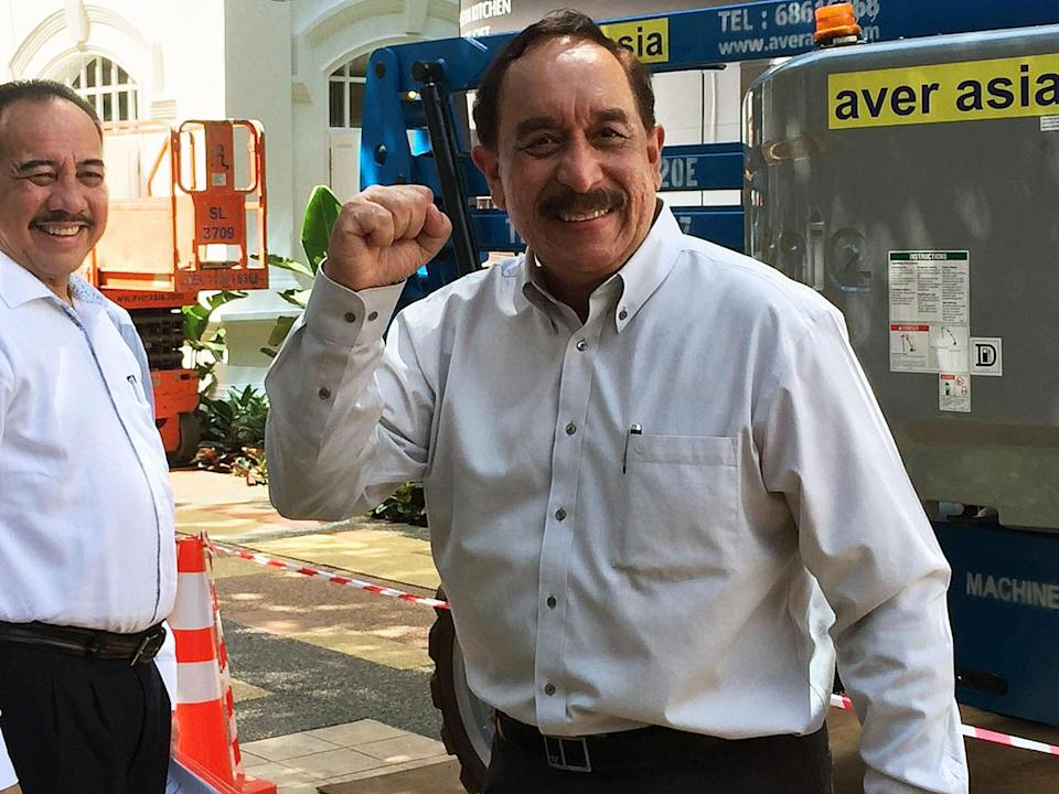 Farid Khan, chairman of Bourbon Offshore Asia Pacific, arrives at the Elections Department on Thursday (24 August) to submit his application forms for the Presidential Election. (PHOTO: Gabriel Choo / Yahoo News Singapore)