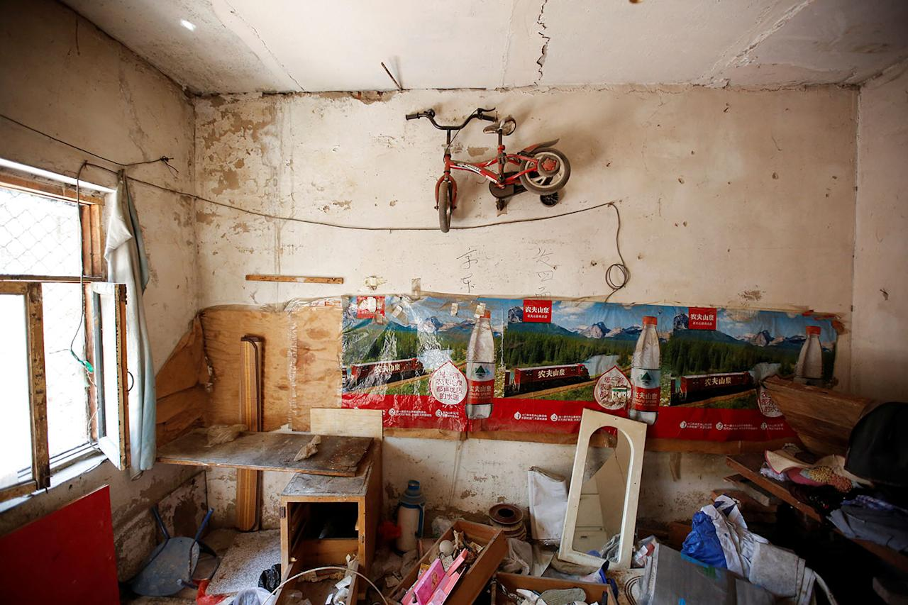 <p>Trash and pieces of furniture are left behind in a vacated former migrant home that is scheduled for demolition at Dongsanqi village in the outskirts of Beijing, China, August 6, 2017. (Photo: Thomas Peter/Reuters) </p>