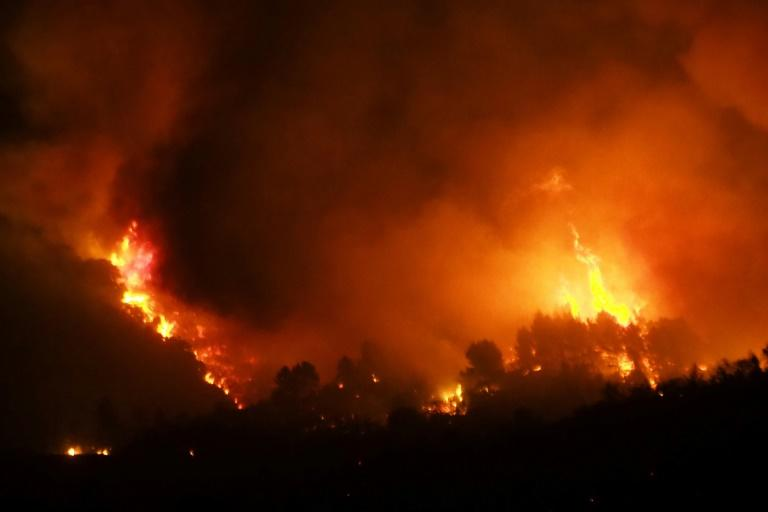 A fire fanned by a strong wind raged early Thursday in the Aude department of southern France but firefighters said they had the upper hand late in the day (AFP Photo/RAYMOND ROIG)