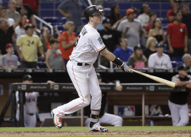 Miami Marlins' Brian Anderson watches his sacrifice fly that scored Miguel Rojas for the game-winning run during the ninth inning of a baseball game against the San Francisco Giants, Wednesday, June 13, 2018, in Miami. The Marlins won 5-4. (AP Photo/Lynne Sladky)