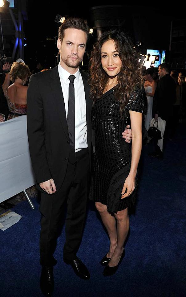 "Shane West looked a tad slovenly (and grumpy!), while his ""Nikita"" co-star Maggie Q was all smiles in her basic black ensemble and magnificent mane. Michael Buckner/<a href=""http://www.gettyimages.com/"" target=""new"">GettyImages.com</a> - January 5, 2011"