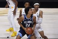 Villanova's Jeremiah Robinson-Earl, front, looks to shoot as Arizona State's Marcus Bagley, back left, and Jalen Graham defend during the first half of an NCAA college basketball game Thursday, Nov. 26, 2020, in Uncasville, Conn. (AP Photo/Jessica Hill)