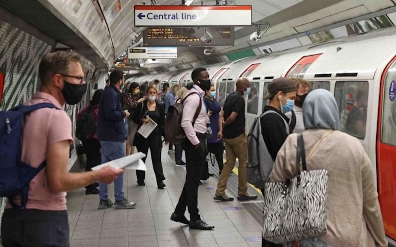 Commuters on the Tube, where journeys yesterday increased by just 6pc on last week - Nigel Howard