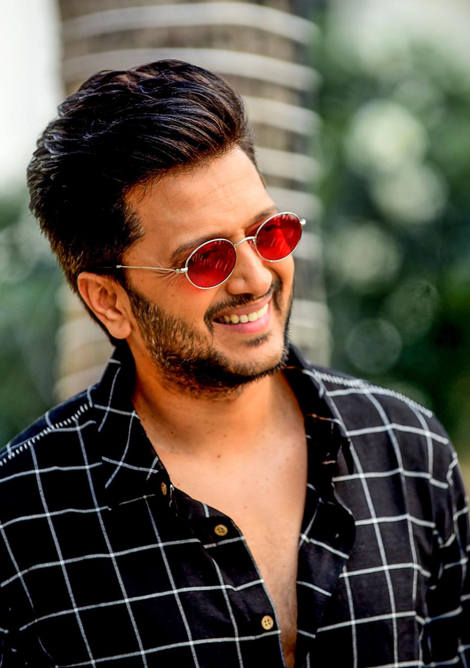 Bollywood actor Riteish Deshmukh poses for photographs during the promotion of his upcoming romantic action Hindi film 'Marjaavaan' in Mumbai on November 13, 2019. (Photo by Sujit Jaiswal / AFP) (Photo by SUJIT JAISWAL/AFP via Getty Images)