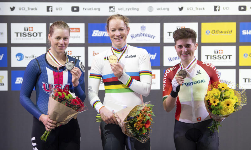 Winners pose with medals on the podium, with let to right, Jennifer Valente from the USA 2nd place, Kirsten Wild from the Netherlands 1st place, and Maria Martins from Portugal 3rd place, after medal presentation for the World Championships Scratch women's track cycle race in Berlin, Germany, Wednesday Feb. 26, 2020. (Sebastian Gollnow/dpa via AP)