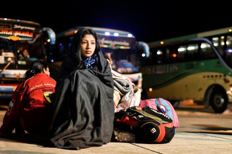 "Nacari, 16, awaits in Huaquillas, Ecuador, border with Peru, after travelling across the country in a bus provided by Ecuadoran authorities as part of a ""humanitarian corridor"" for Venezuelans fleeing their country's economic crisis on August 25, 2018"
