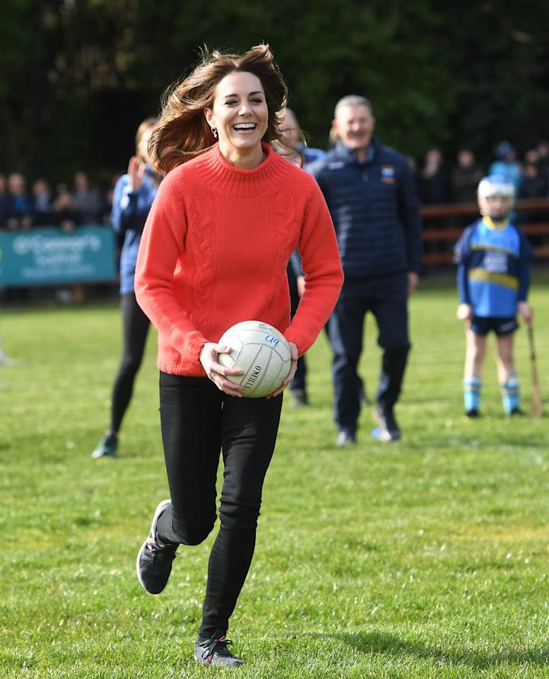 <p>Kate looked ecstatic playing Gaelic football with Irish children.   </p>