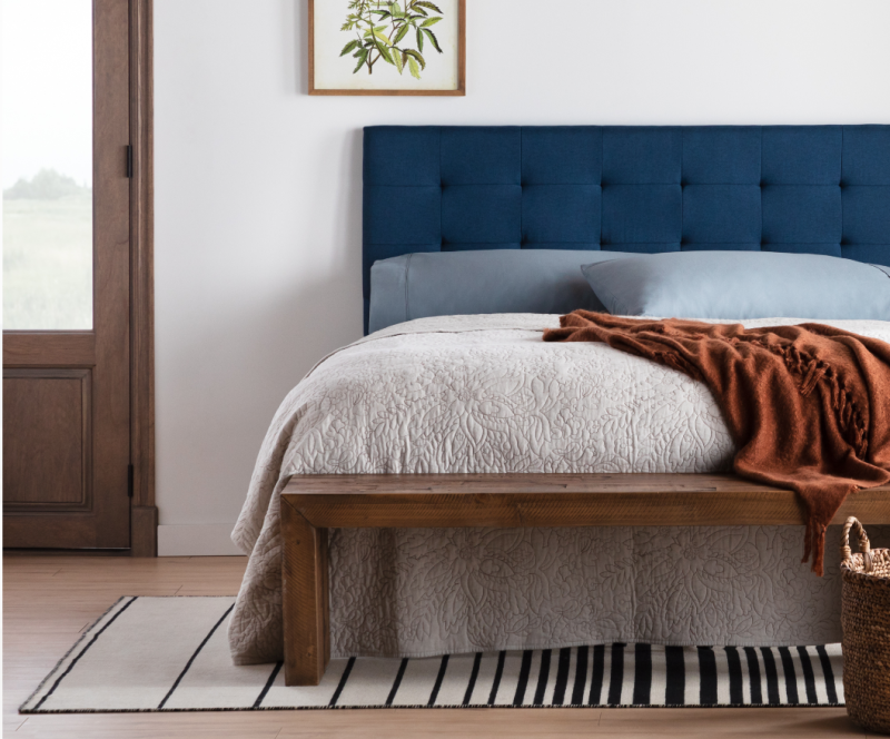 This tufted navy headboard could be just the pop of color your bedroom needs. (Photo: Walmart)
