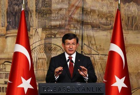Turkish Prime Minister Davutoglu addressess during a joint news conference with German Chancellor Merkel in Istanbul